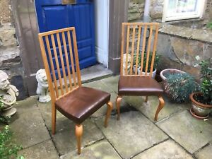 A pair of 20th century tall back beech wood chairs in the Scandinavian taste