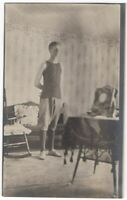 021621 VINTAGE RPPC REAL PHOTO POSTCARD YOUNG MAN ATHLETE IN PARLOR