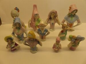 11 pin cushion half dolls