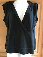 One Girl Wh black sleeveless top with hood & front warmn pockets sM
