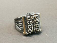 V8 engine ring with 8 black cubic zirconia, black rhodium and gold details