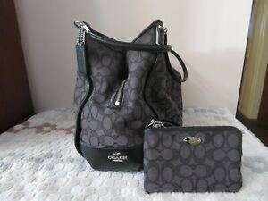 Authentic Coach shoulder bag with matching wristlet (color in black monogram)