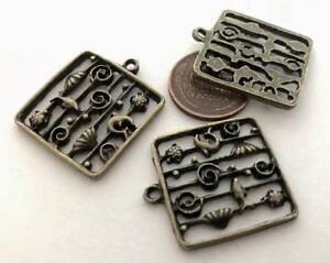 Old Stock 23 x 27mm Bronze Tone Metal Fish Marine Life Charms 3