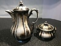 Coffee pot and matching sugar jar very nice unusual