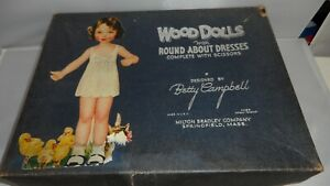 WOOD DOLLS WITH ROUND ABOUT DRESSESS  BY BETTY CAMPBELL.