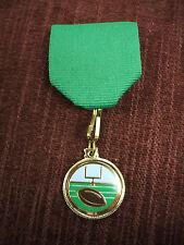 Football green medal trophy award pin