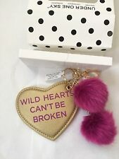 """""""WILD HEARTS CAN'T BE BROKEN"""" KEYCHAIN WITH POM POMS, BOXED, $22 RETAIL"""