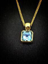 9CT YELLOW GOLD PENDANT SET WITH SQUARE BAGUETTE CUT BLUE TOPAZ