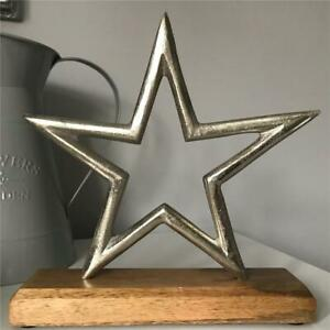 New Silver Colour Metal Star on wooden base approximately 21 cm high