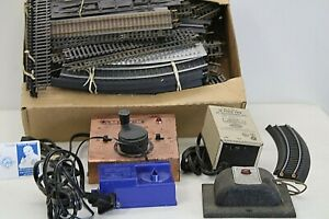 Lionel Train Tracks - 97 Pieces of Track + 4 Power Supplies