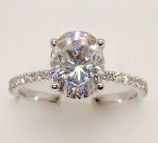 14k WHITE GOLD DIAMOND AND OVAL MOISSANITE ENGAGEMENT RING