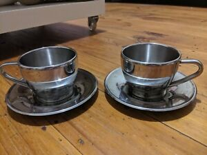 Pair Cappuccino Stainless Steel/Chrome Double Walled Cups With Saucers