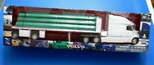 New-Ray ~ Volvo VN 780 Semi with pipe trailer 1/32 scale