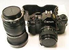 Canon A-1 film camera w New FD 50mm f1.4 & 35-105mm f3.5 Macro Zoom  Super Clean