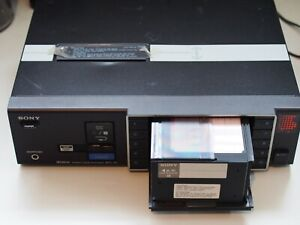 Sony MTL10 Cassette Changer with cartridge for parts or repair.