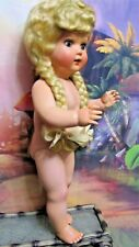 Vintage Plastic or celluloid girl 1940-1950 painted eyes, wig, dressed