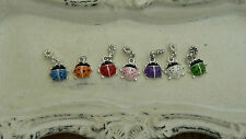2 lady bug charms/pendentifs 8 -10 mm rouge