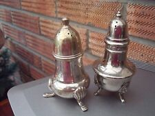 Pair of Silver Plated Pepperettes Pepper Pots Shakers one with lion head feet.