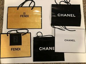 Three Chanel and Two Fendi Shopping Bags