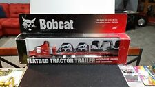 1/50 Bobcat Flatbed Semi with skid loaders and excavators