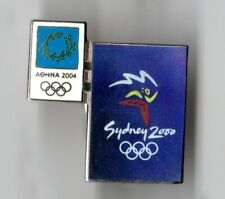 ATHENS 2004. OLYMPIC GAMES PIN. POSTER OF SYDNEY OLYMPICS 2000