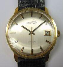 Orologio da polso in oro Eberhard automatico con datario. Anno 1975 .