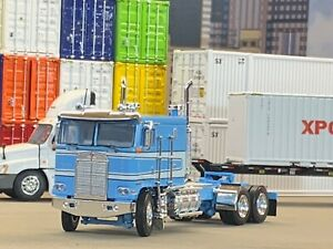 1/64 DCP BABY BLUE/WHITE KENWORTH K100 FLAT TOP LONG FRAME