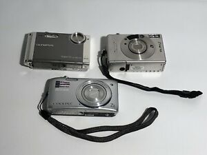Lot Of 3 Cameras Olympus Stylus730 / Nikon Coolpix / Canon Glph2