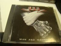 RAR  CD. U.D.O. MAN AND MACHINE. HEAVY METAL