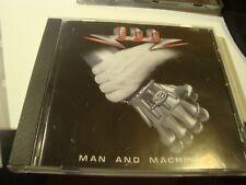 RAR  CD. U.D.O. MAN AND MACHINE. HEAVY METAL