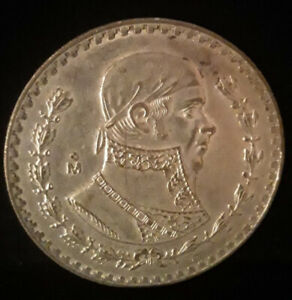 Vintage 1964 one peso silver coin from Mexico. Circulated but nice.