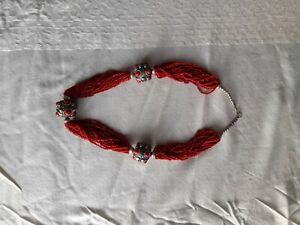Collier ancien en perles de corail rouge - 18 rangs torsadés 60 cm