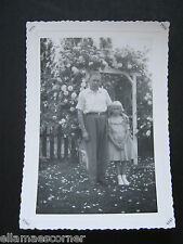 Vintage 1958 Black and White Picture of Man and Girl
