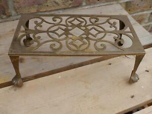 VINTAGE brass ORNATE PAN STAND TRIVET - stands on high feet