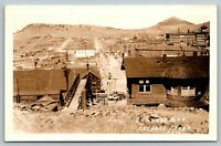 Cripple Creek CO~Bennett Avenue From Hilltop Stairs~MTK Railroad Car~1930s RPPC