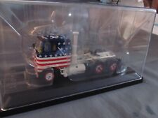 """Mack F-700 cabover.  """"American Flag""""  1/50th scale.  Tekno."""