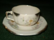 AMERICAN LIMOGES  FLORAL CUP AND SAUCER SET
