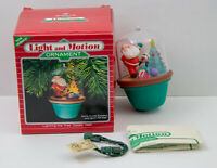 Vintage Hallmark Santa Lighting the Tree Light & Motion Christmas Ornament 1986