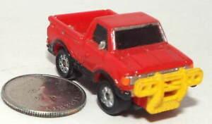 Small Micro Machine Datsun Pickup Truck in Red with Yellow Push Bars