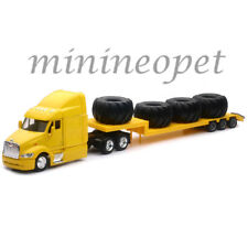 NEW RAY SS-15113N LONG HAUL TRUCKER PETERBILT MODEL 387 LOW BOY w BIG TIRES 1/43