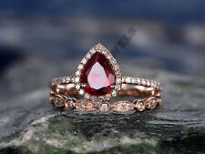 pear shape red ruby & white diamond rose gold over wedding women bridal ring set