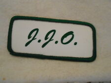 J. J. O.   USED SILK SCREEN NAME PATCH TAG  GREEN ON WHITE