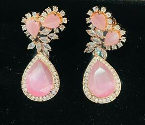Rose gold earrings with pink stone designer alloy based earings