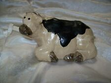 """A Resting Cow By """"The Garden Collection"""""""