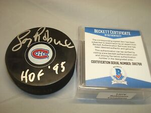 Larry Robinson Signed Montreal Canadiens Hockey Puck HOF 95 Beckett BAS COA 1A
