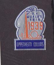 Vintage label  1939 NY WORLDS FAIR  OPPENHEIM COLLINS silver metallic  #IM