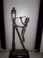 Sculpture by Stephen S. Allwell of Man on Ladder Lighting Lamp