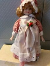 New Porcelain Doll Baxter and Smythe 8 Inch Girl in Pinafore and bonnet