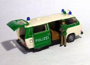 H0  1:87 Modell - Umbau / Gesupert - VW T3 Syncro Polizei Figur Schiebetür offen
