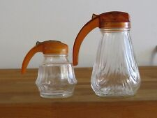 2 Old clear glass syrup pitchers in great condition
